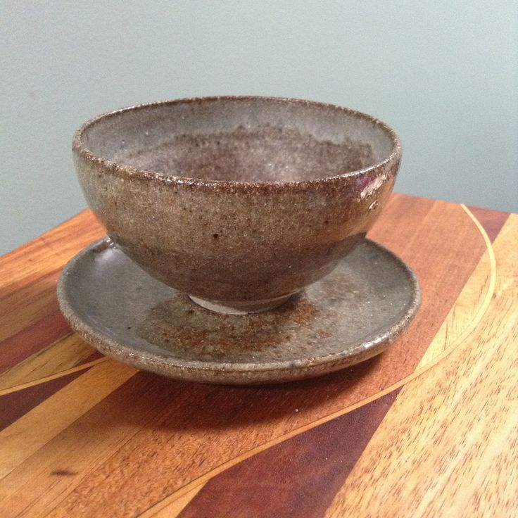 Stoneware cup and saucer, Japanese style. Matt white glaze on the interior, oak ash with cobalt speckle on the outside. fionawallaceceramics.com
