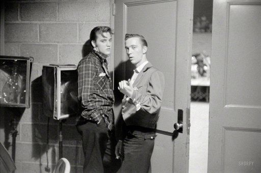 May 27, 1956. Dayton, Ohio. Elvis Presley with his cousin Gene Smith backstage at the University of Dayton field house, on the threshold of superstardom.  Phillip Harrington for Look magazine.