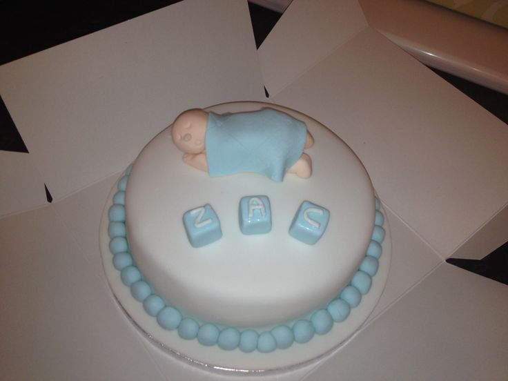 Chocolate sponge with chocolate buttercream and fondant baby for my friends new baby boy