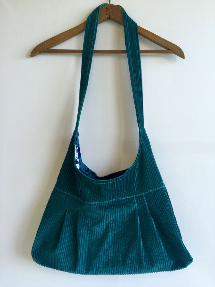 Handmade handbag. Teal corduroy with vintage large blue flower fabric.