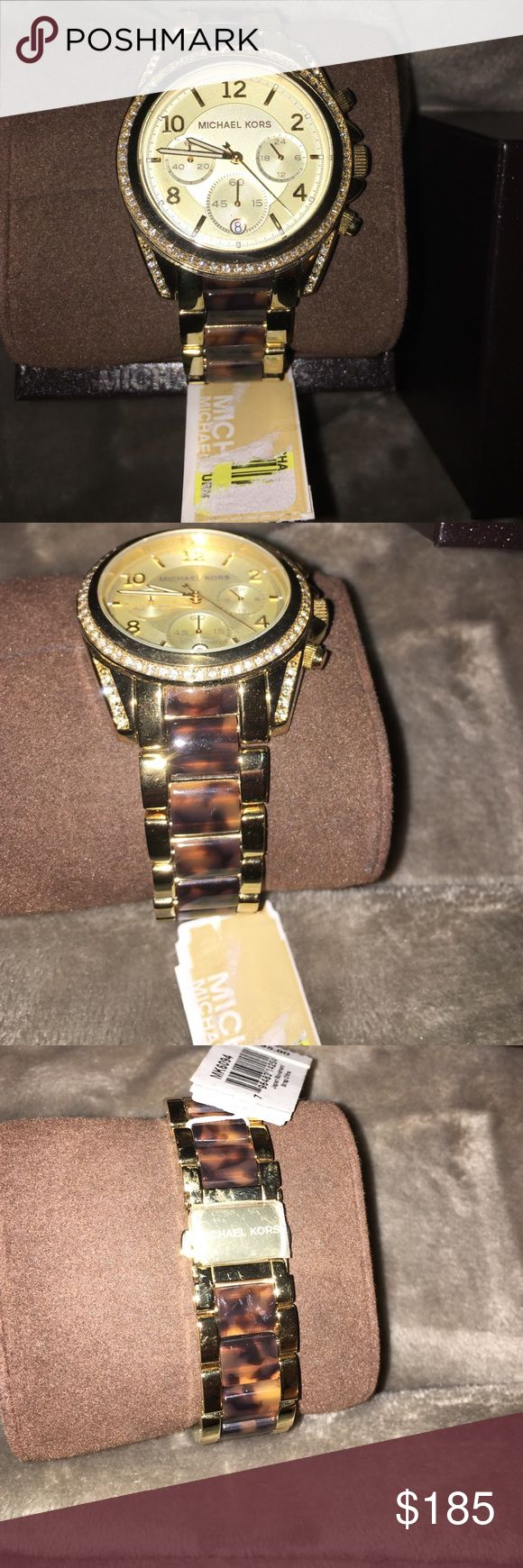 Women's two-tone Michael Kors Blair watch MK6094 New with tags in original MK hard box. Tortoise color band and gold. Glitzing stones. Steel clasp. Water resistant (100). Chronograph Michael Kors Accessories Watches