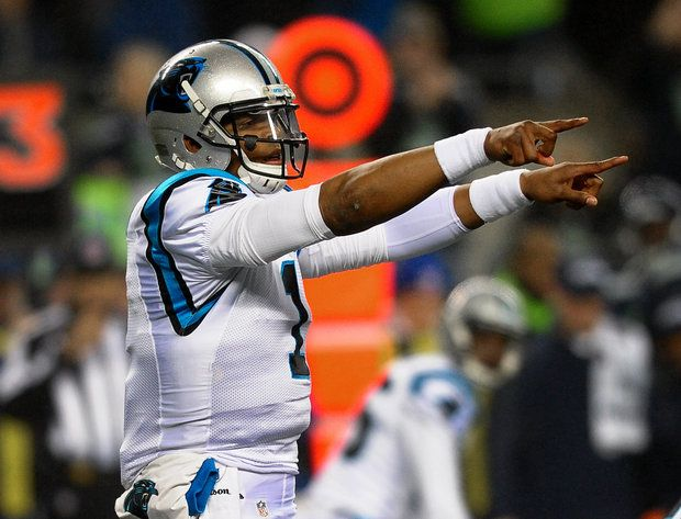 Carolina Panthers quarterback Cam Newton (1) directs the team's offense vs the Seattle Seahawks during first quarter action at CenturyLink Field in Seattle, WA. on Saturday, January 10, 2015. The Seattle Seahawks hosted the Panthers in NFC Divisional Playoff action.