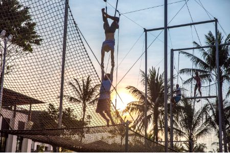 There's no better time for a twilight catch.  Picture yourself soaring through the air on Club Med's flying trapeze, with a magnificent sunset sinking into the horizon as a backdrop…