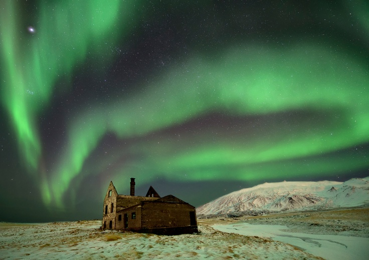 Abandoned home in Iceland framed by the Aurora Borealis. Beautifully surreal!