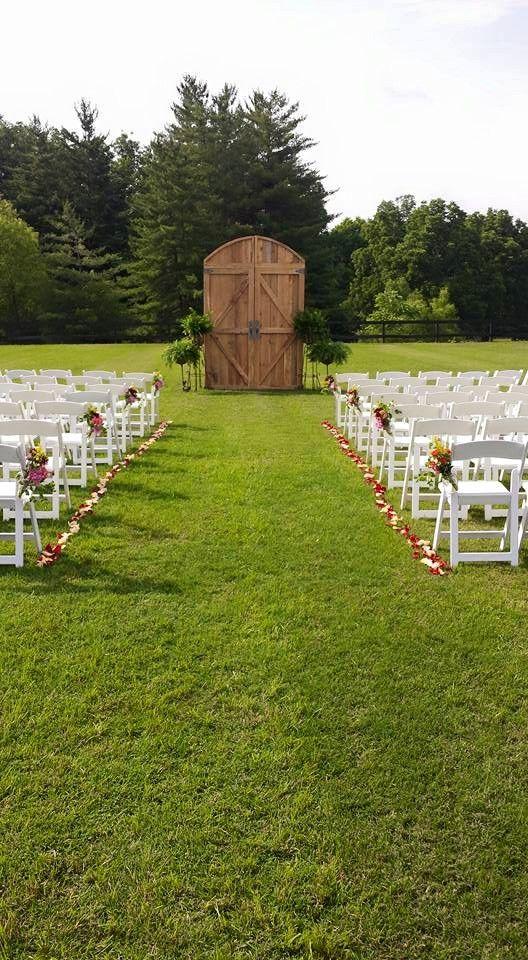 Barn door wedding ceremony arch.