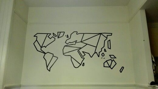 Geometric world map wall mural. Made from electrical tape. Cost under £3. So cheap, and makes a huge impact on a big empty wall.
