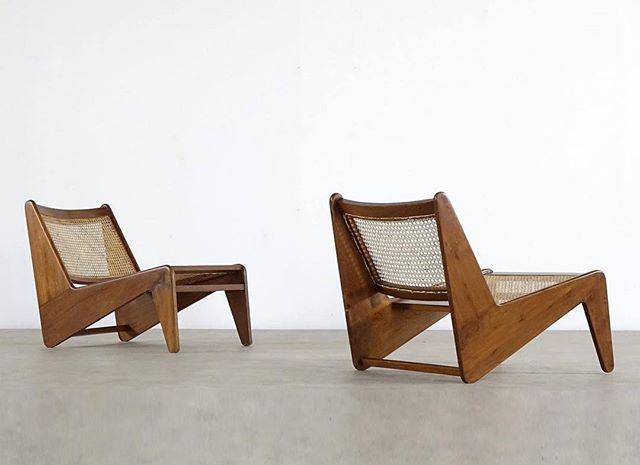 A pair of 'Kangaroo' chairs designed by Pierre Jeanneret