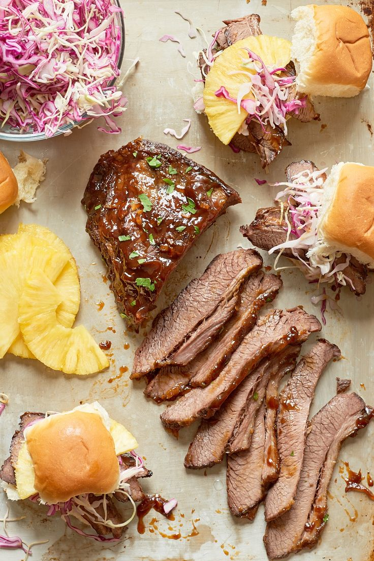 Pillowy-soft Hawaiian rolls piled high with slices of tender beef brisket and sweet pineapple, all topped with a crunchy, refreshing cabbage slaw.