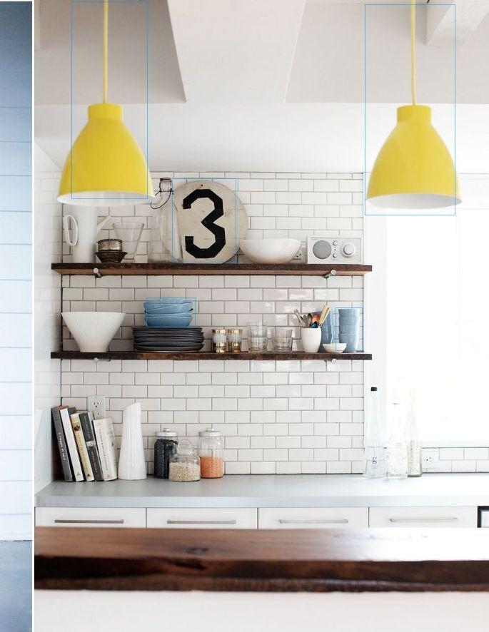 Subway tile and mustard pendant lightening and open shelves