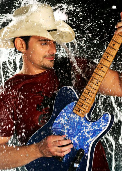 Brad Paisley...saw him in person and he is such a good performer (and cute little thing)