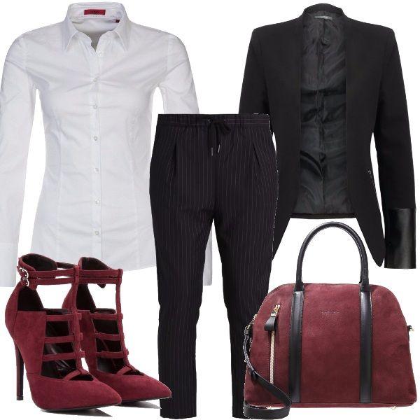 Un outfit mannish con il colore della stagione: il bordeaux. Camicia bianca in stile classico ma dal taglio slim, giacca con un tocco di trasgressione dato dai dettagli in ecopelle, pantalone gessato in stile boyfriend. Scarpe e borsa bordeaux pongono l'accento sulla femminilità.
