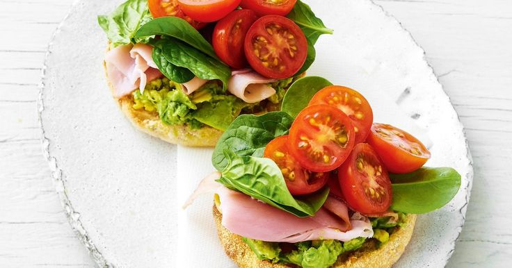 Spicy avocado toasted muffin with shaved ham and spinach