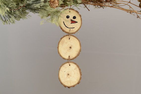 Handmade Snowman ornament made from natural tree branch slices. Each slice is approximately 2 inches around and measures 6-7 inches for the