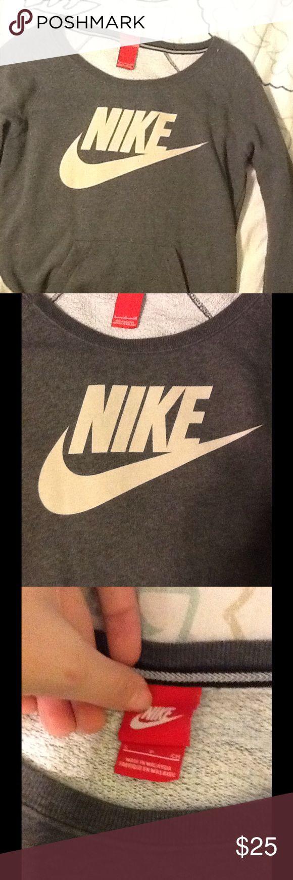 Nike crew neck sweatshirt Cute and warm Nike crew neck sweatshirt. Only worm 2 times, nothing wrong with it. Nike Tops Sweatshirts & Hoodies