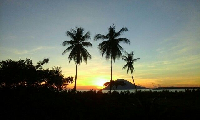 Sunset featuring Manado Tua island Grand Luley Resort