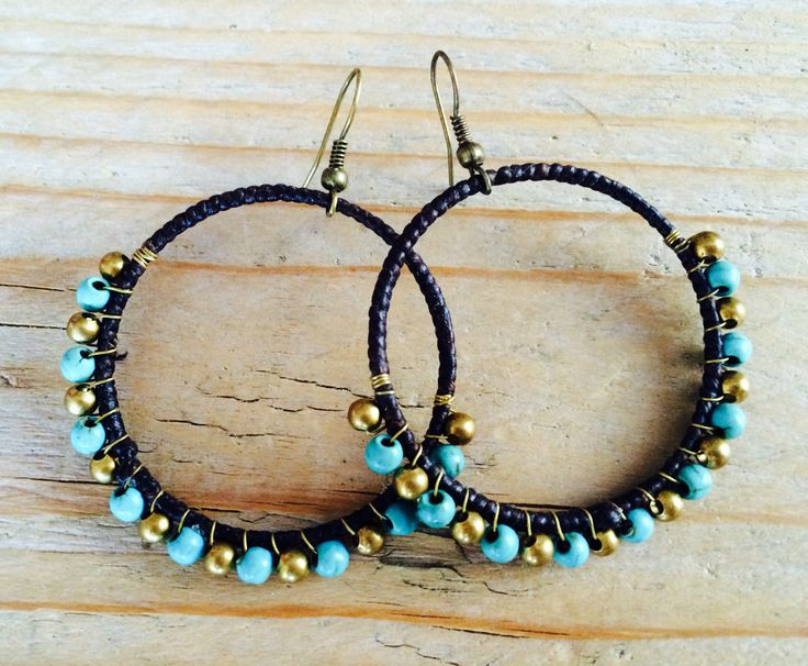 Round with turquoise and golden beads. Save to ware, Nickel and Lead free. €12,50