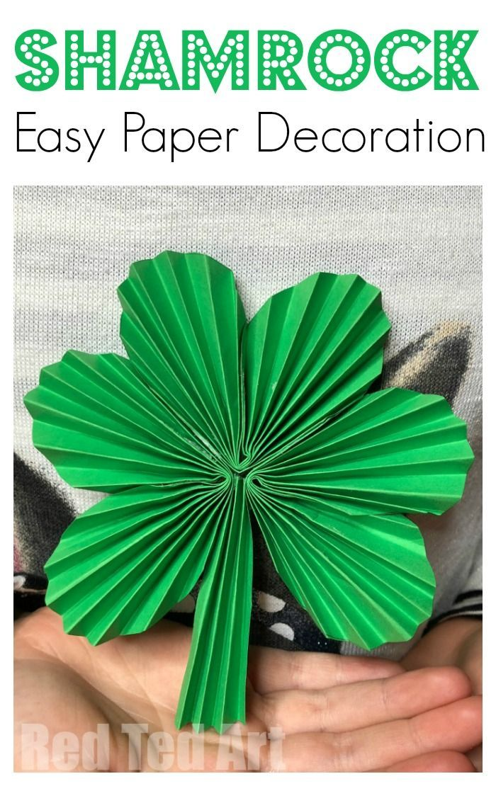 Paper Fan Shamrock Decorations - Happy St Patrick's Day! A great easy Paper St Patrick's Day decoration to make with the kids. Turn paper into fabulous Paper Fan Shamrocks. String them up as Paper Shamrock Garlands or hang them individually! addictive to make too!