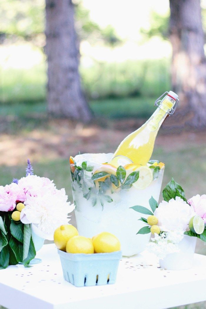 DIY citrus ice bucket is beautiful for outdoor parties and easy to make! Fill it with flowers or berries too via ajoyfulriot.com