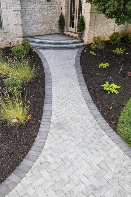 Mix and match your Cambridge Pavingstones with ArmorTec to help highlight landscaping and add extra curb appeal!  This entryway was installed by Plantique.