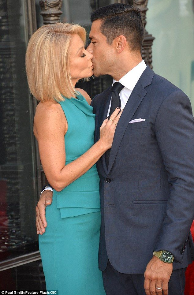 ♥♥♥Kelly Ripa♥♥♥ Sealed with a kiss: The Live! With Kelly And Michael host stole a smooch from husband Mark...
