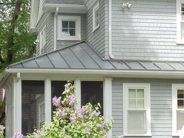 Metal roof houses modern metal roofing vs shingles for Images of houses with metal roofs