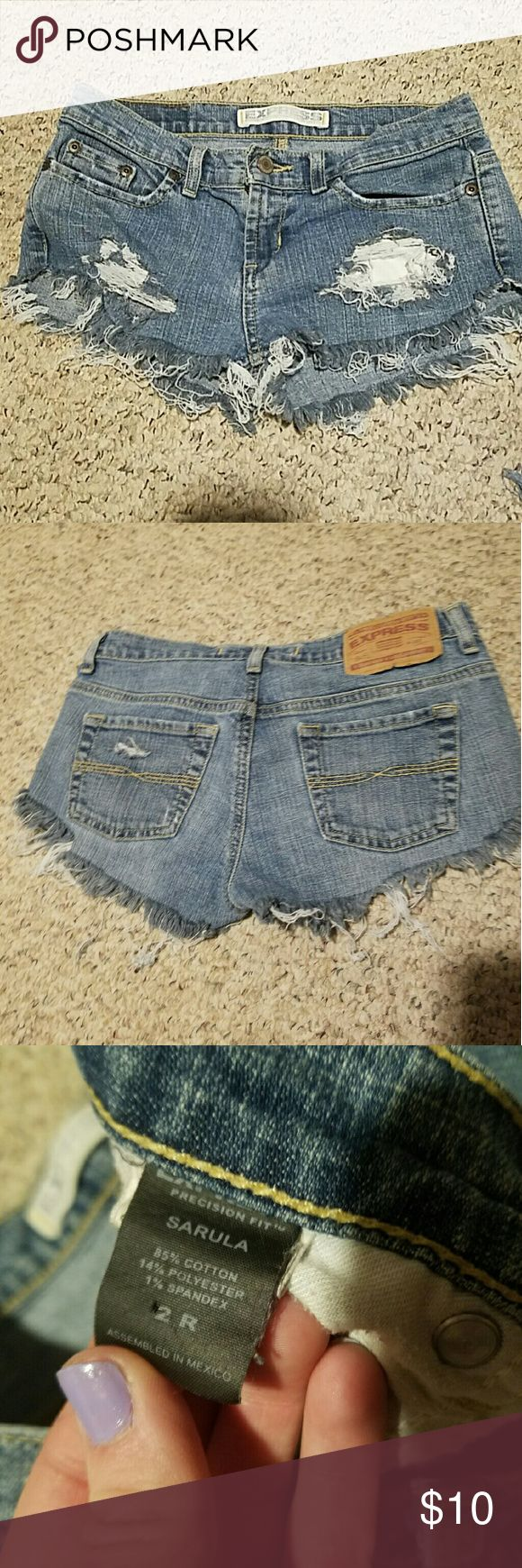 Express cut-off Jean shorts Size 2 Express vintage style cut-off Jean shorts, work a few times, we're too small, but very cute for summer. Express Shorts Jean Shorts