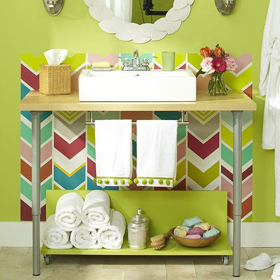 Add-ons make a simple vanity a storage workhorse. An L-shape shelf and towel bar create practical places for hand towels and extra supplies to land. Decorative glass containers and baskets create a pretty and practical display.