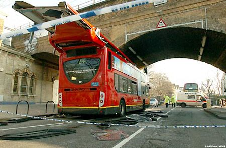 A number 24 bus crashes into the bridge at Kentish Town West underground station, London ( February 2008).