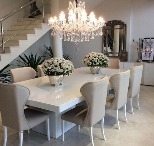 Oh la la! Love the clean modern table paired with the traditional crystal chandelier.