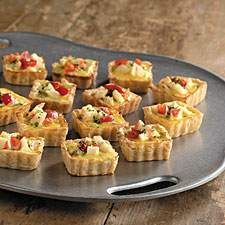 Crab and cheese quiches are baked in tiny squares, so they're perfect appetizers.
