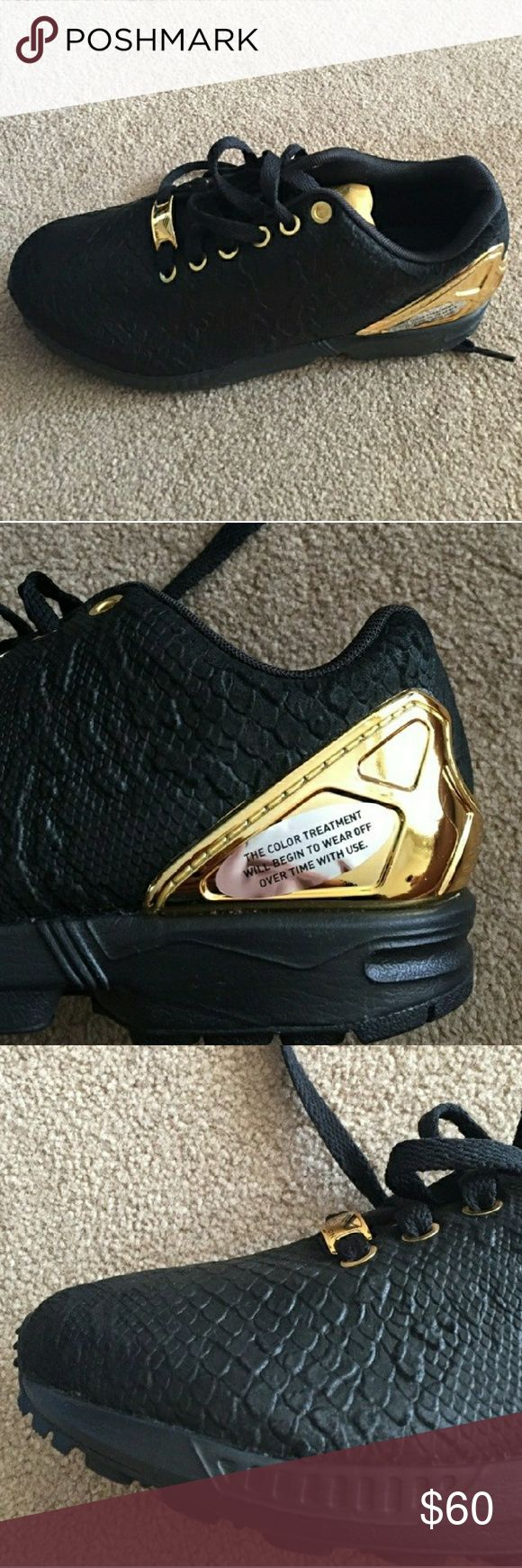 ADIDAS ZX FLUX Black and gold snakeskin print shoes Excellent condition  Only worn a few times  Youth size 5, but Adidas runs bigger, so fits more like a women's size 7.5  I think Nice looking shoe, just too big for me Adidas Shoes Athletic Shoes