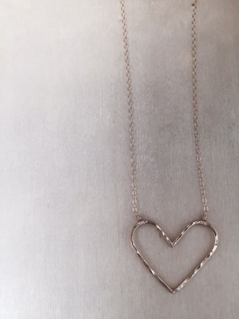 An open heart is a happy heart. Our Open Heart necklace features a 14k gold fill or sterling silver hammered heart necklace.  xo JM