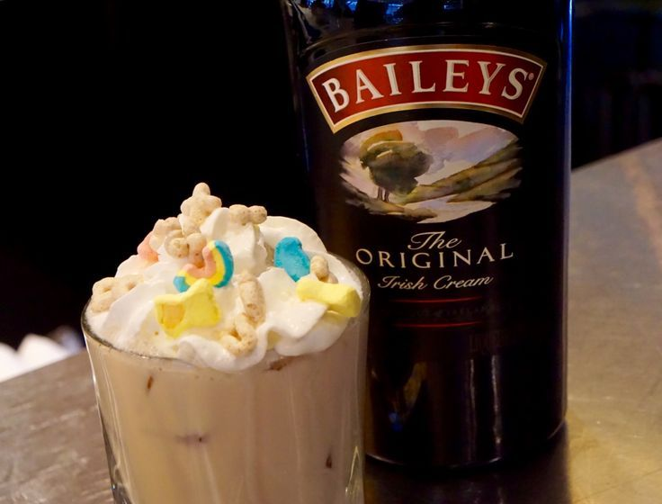 The Lucky Charm Cocktail Recipe is a fun way to celebrate St. Patty's Day with some Bailey's and topped with Lucky Charms Cereal!