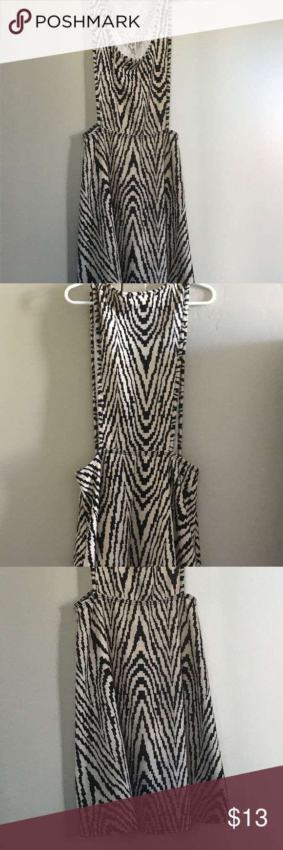 Cocktail Casual Dress Sz Small Beige Black Print Beige Black Print Dress. Fun, flowy, sexy. Dress up or down with a sweater, long sleeve for winter or nothing on the bottom for a night out to a bar or club. Size Small. Stretchy material. Worn once. ( Necklace not included ) Dresses Midi