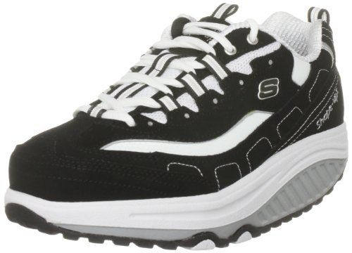 "Skechers Women's Shape Ups - Strength Fitness Walking Shoe,Black/White,7.5 M US (884390676683) Nubuck Leather Upper Sculpted Rubber Sole Fabric Side Panels Lace-Up Closure Midsole Measures Approximately 1.5"" At Center"