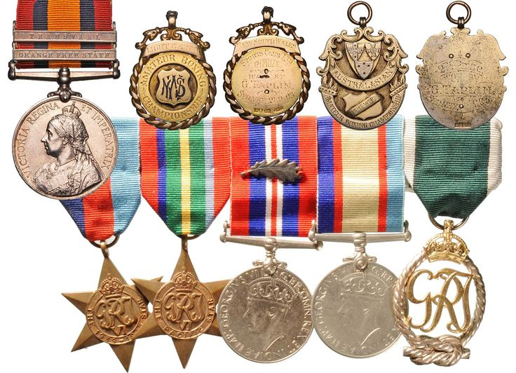 "Boer War/WWII family group:Boer War QSA bars ""Transvaal"" and ""Orange Free State"" impressed to 406 Tpr G.Taplin N.S.Wales MRWWII Group of Five; 1939-45 Star and Pacific Star unnamed as issued, War Medal with MID oak leaf and ASM impressed J.A.Taplin RANR(S), Royal Naval Reserve long service decoration George VI type reverse ""1942"".  Lot: 711. Estimate: $2,500"