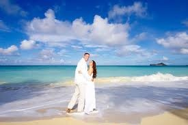 Renew our vows on the beach in Hawaii... Just the two of us, in a dress he picks out for me...