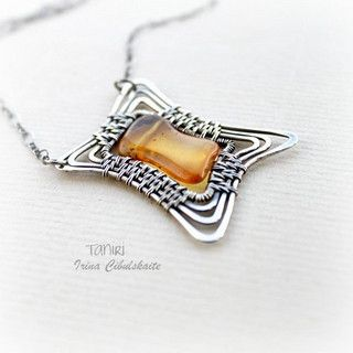 silver wirework pendant by taniri - love the irregular frame, reminds me of Harry Potter! - mk