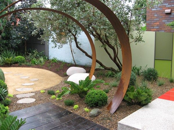 Steel arbour in a garden by Brendan Moar - loved this garden except the fake grass mound