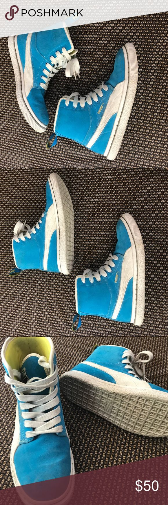 Women PUMA Blue Suede Hi-Tops Worn a few times. These are big hi tops for ladies size 8. Light baby blue suede color with yellow interior color. Very comfortable and outgoing shoes. Not worn out from the bottom at all. Pretty sturdy material. Puma Shoes Sneakers