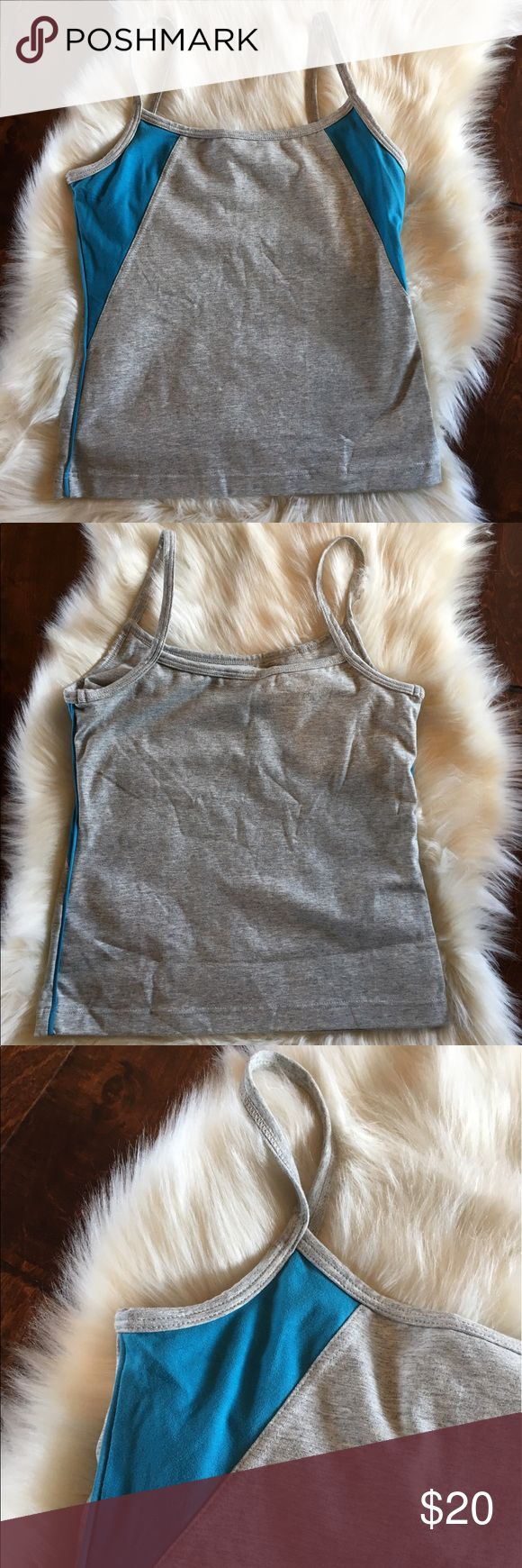 """J. Crew Gym Tank Top with Built in Bra J. Crew Gym tank top with built in shelf bra. Size medium.  Has spaghetti strap. Color is heathered grey with turquoise blue trim. Measures about 21"""" from strap to bottom hem and about 14.5"""" across the chest.  Offer and bundles welcome! J. Crew Tops Tank Tops"""