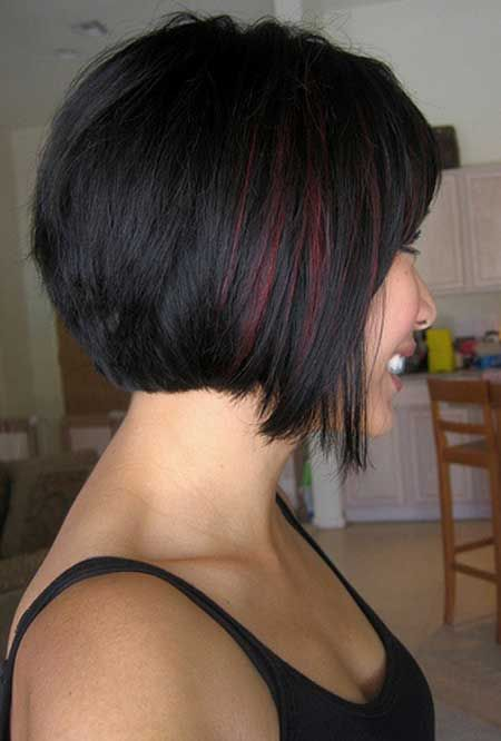 Pretty bob haircut, straight across back and longer piece surrounding the face and chin. Blacky-auburn colour with auburn streak.