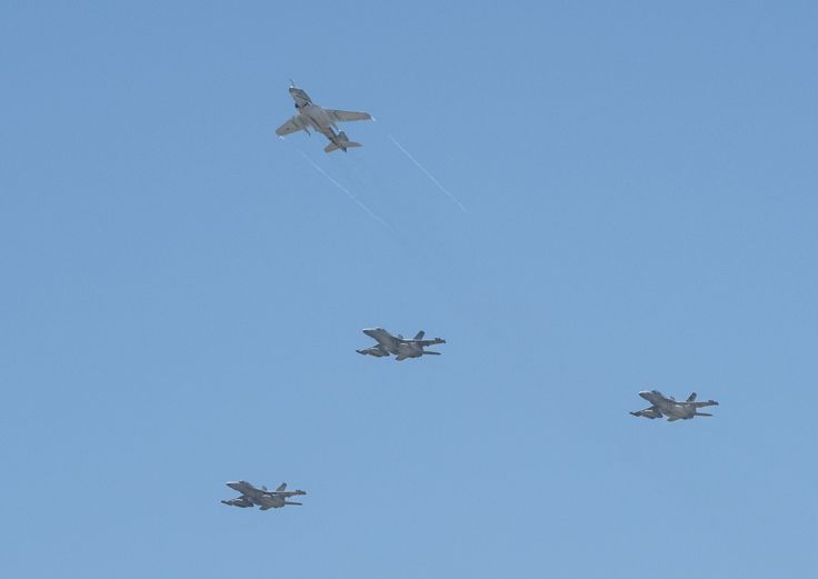 "Three US Navy EA-18G Growlers (bottom) and an EA-6B Prowler aircraft perform a ""missing man"" formation as part of a memorial ceremony held June 26 2015 at Naval Air Station Whidbey Island. The ceremony celebrated the lives of all the naval aviators and maintenance personnel who died serving the electronic attack mission of the Prowler.Edgar Mills, Northrop Grumman"