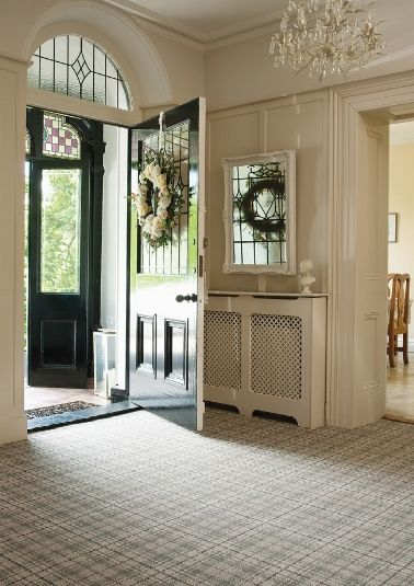 I'm not a huge carpet lover however the plaid carpet seems to work beautifully in this space and those radiator covers love!!!!!