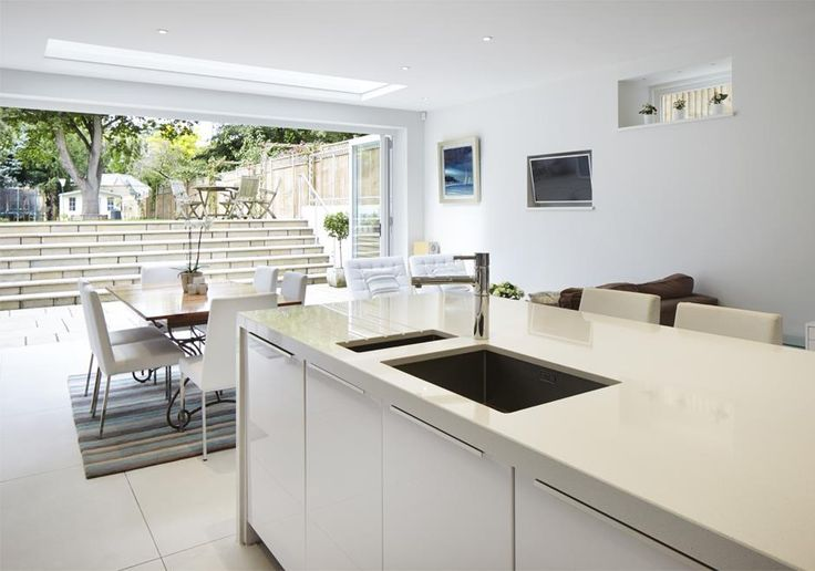 New build period house in  SW London. The basement leads out to the terraced garden giving a beautiful flow from the open plan kitchen dining area into the garden.
