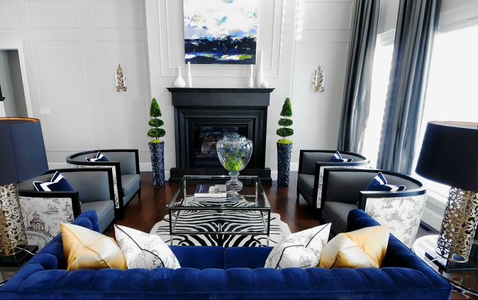 love this room.  love the glam details, the zebra print rug, and the blue