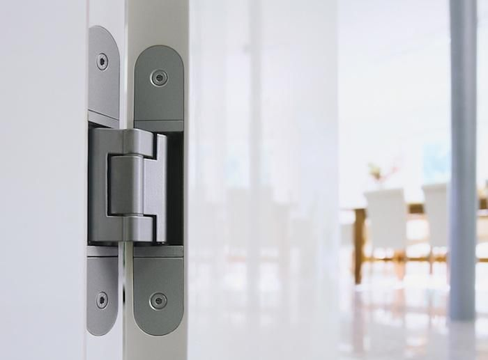   DOOR HARDWARE   Tectus 3D Concealed Hinges come in a choice of ten finishes.  http://www.betterbuildinghardware.com/