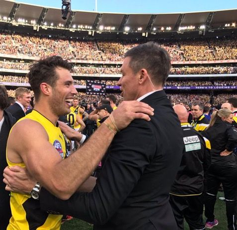 Alex Rance with Mathew Richardson dressed in the suit.