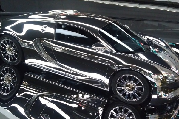 Bugatti covered in liquid silver in the Premium Clubhouse Pavilion at Autostadt. credit Jessica Caldwell