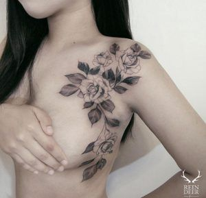 Beautiful sprawling floral shoulder tattoo design by Reindeer Ink | Black and White Tattoos | Tattoos for women